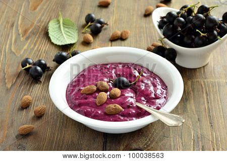 Tasty black currant smoothie with almonds and berries
