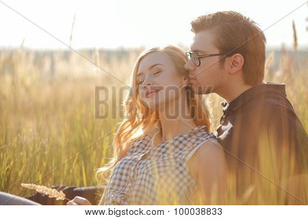 Attractive young loving couple is dating in the nature