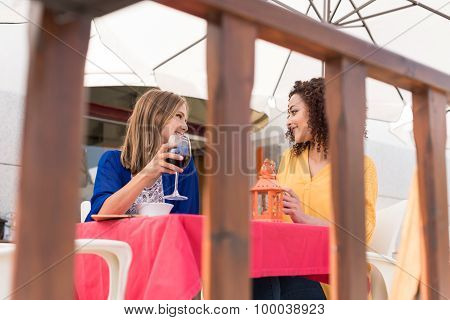 Multi-ethnic Friends At Bar's Balcony