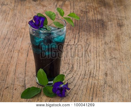 Butterfly Pea Water on wooden background.
