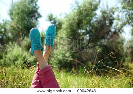 Female legs in colorful sneakers outdoors