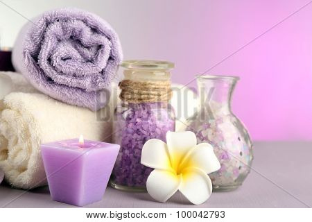 Spa treatments on colorful background.