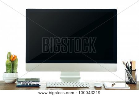 Computer on wooden table with blank white background