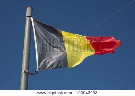 Flag Of Belgium Under Blue Sky