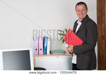 Middle Age Businessman Working On Laptop Computer