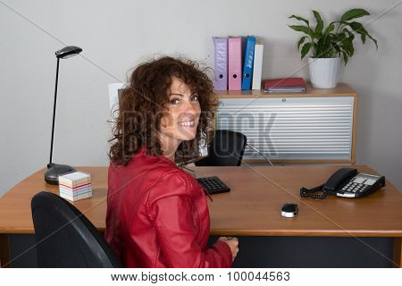 Business Girl With A Red Leather Jacket At Work