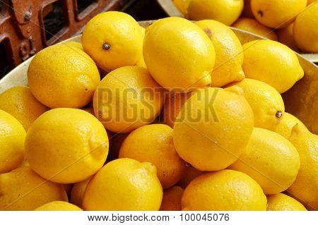 Lots of fresh yellow lemons at the market