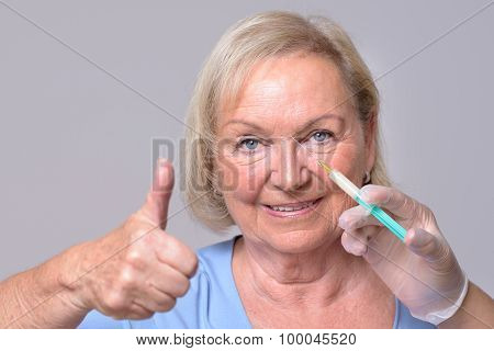 Satisfied Woman With Injection On Face