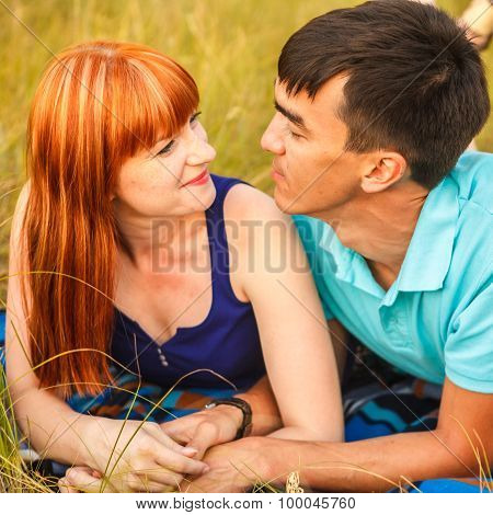 Couple Lying Next To Each Other In A Meadow, Outdoors