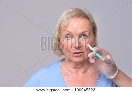 Cosmetic Injection On The Face Of Senior Woman