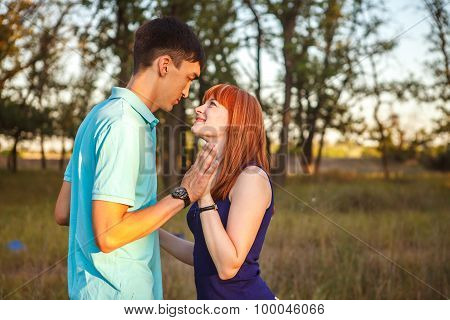 Young Couple Walking Hand In The Forest Outdoors