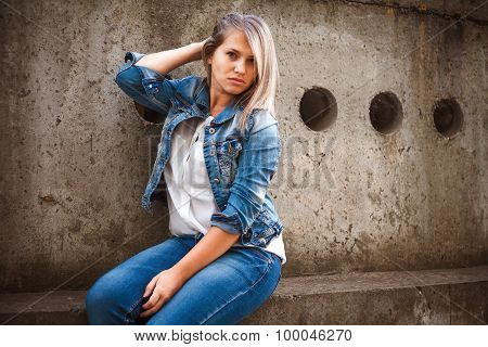 Beautiful Girl In A Denim Suit Posing In City Outdoors