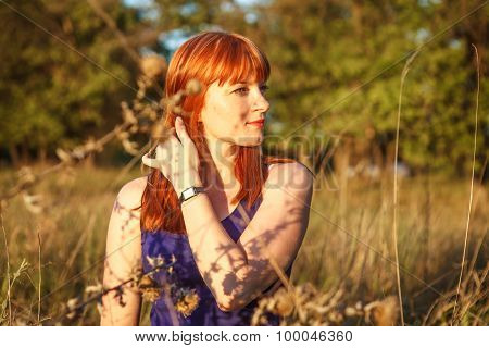 Beautiful Red-haired Girl Posing In The Outdoors