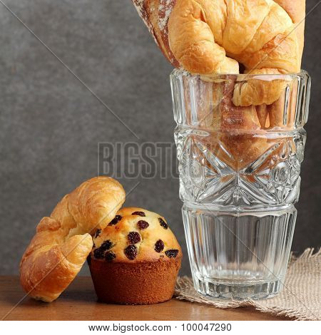 Croissant Brad Muffin  Bakery In Glass Blow On Teakwood Table