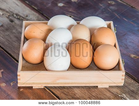 Mixed White And Brown Color Eggs  Put On The Wood Floor
