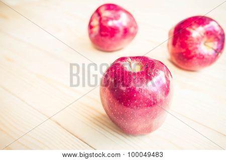 Apple On The Wooden Floor.
