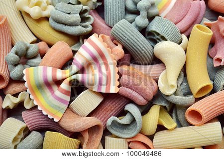 Set of different kinds of colorful Italian pasta on wooden table