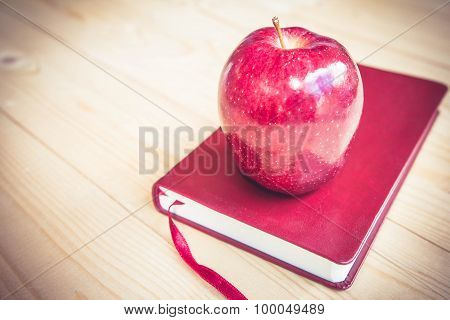 School Teacher's Desk With Books And Apple.