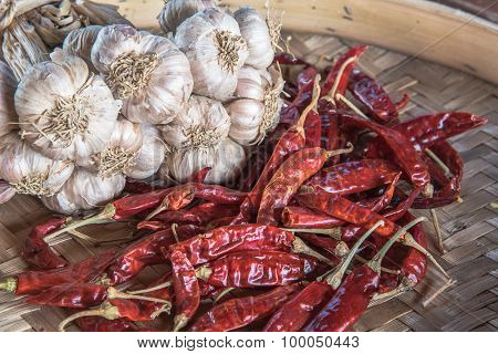 Dry Garlic And Dry Chili On The Wooden Table