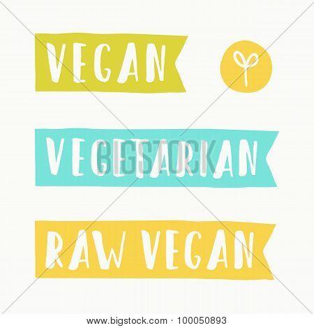 Vegan, vegetarian and raw food signs.