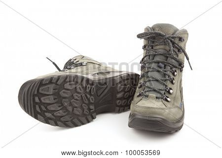 Couple of trekking new shoes isolated on white background