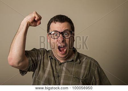 Geek Raising His Hands In Anger