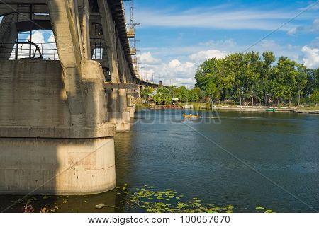 Autumnal landscape with old railroad arched bridge