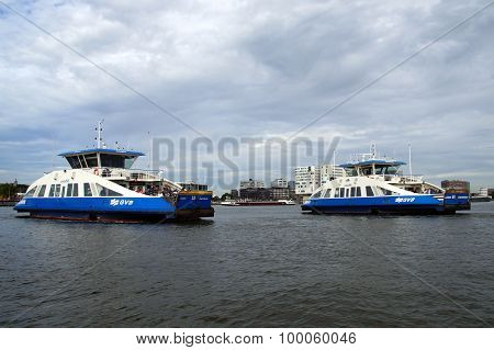 Dutch passenger ferries passing by -  Amsterdam