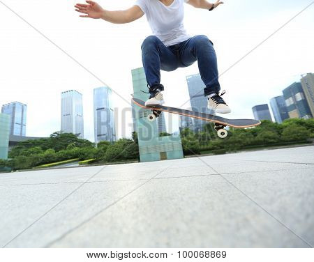 closeup of young skateboarder skateboarding on city