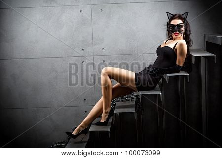 Sexy Woman In Suit Lying On Stairs