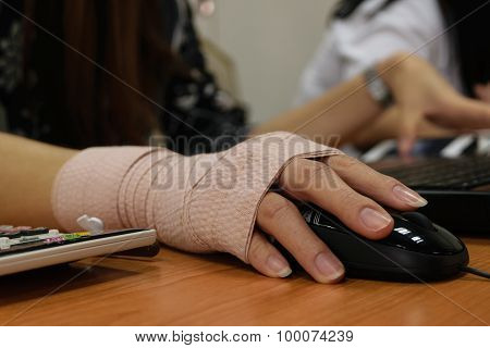Asian women hand sore working on her computer poster