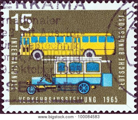 GERMANY - CIRCA 1965: A stamp printed in Germany shows Old and modern postal buses