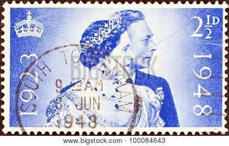 UNITED KINGDOM - CIRCA 1948: Stamp shows King George VI and Queen Elizabeth