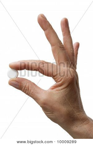 one hand holding one tablet isolated on white background