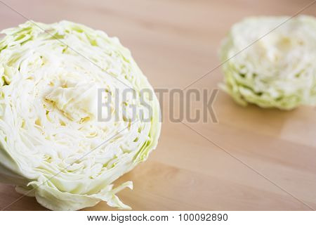 Raw cabbage sliced on wood table