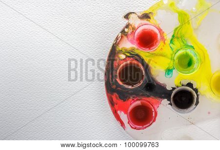 Colorful Palette On Drawing Paper Background  With Texture.