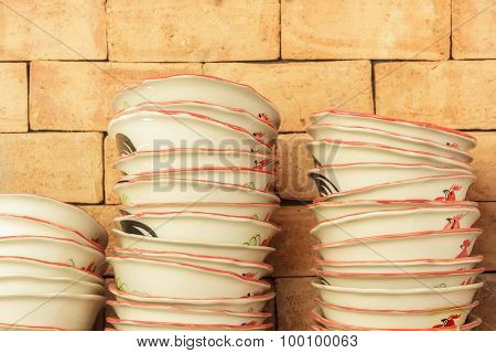 Stack Of Brown Bowl In Warehouse.