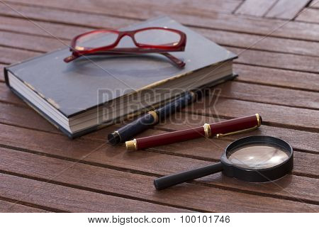 red eyeglasses on a book
