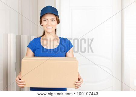 Nice deliverywoman standing near door