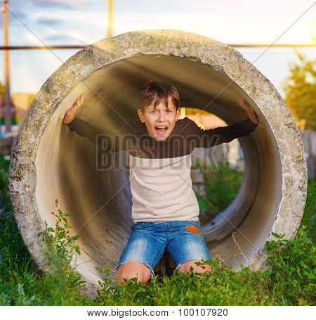 Teen boy shouts in a tube claustrophobia agoraphobia mental illn