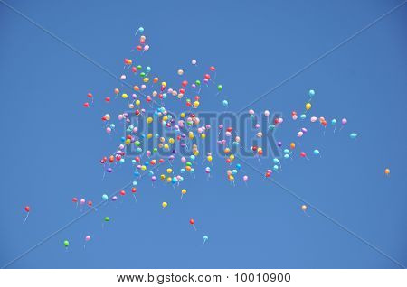 Balloons In The Blue Sky.