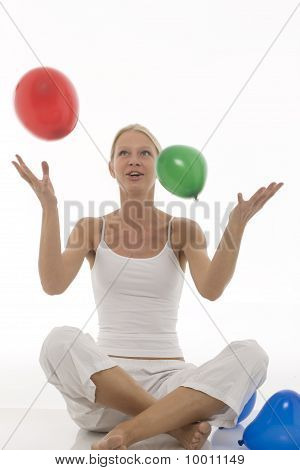 young beautiful caucasian woman with balloons