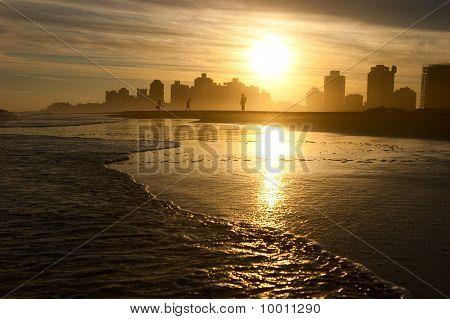 Evening walk on the beach. In family circle. Uruguay. Punta del Este. poster