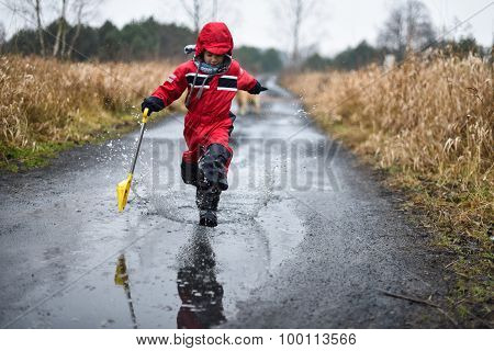Young Boy Running Through A Paddle