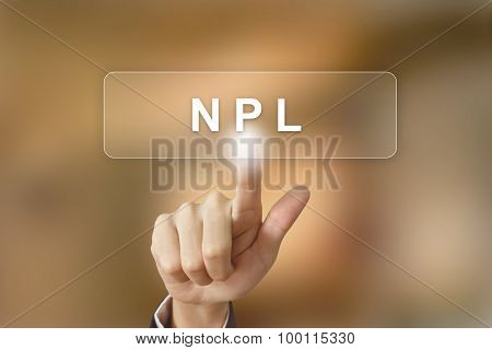business hand pushing NPL or non performing loans button on blurred background poster