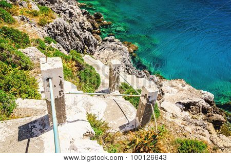 Green bushes and stairs to the beach, Greece