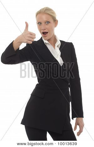 portrait of a young caucasian businesswoman with thumb up wearing a jacket and trousers
