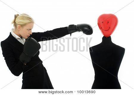 portrait of a young caucasian businesswoman with aggressive air wearing boxing gloves and punches a