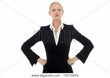 portrait of a young caucasian businesswoman with aggressive air wearing a jacket