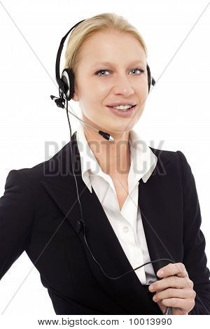 portrait of a young caucasian operator smiling with headphone and microphone